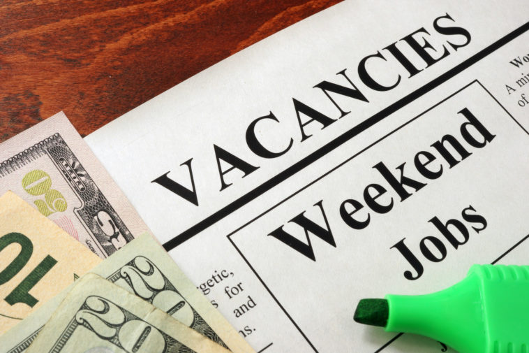 Newspaper with ads weekend jobs vacancy. Occupation concept.